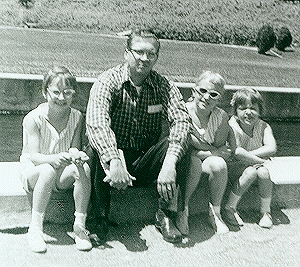 Me, my father, my older sister and younger sister. Happy family time.