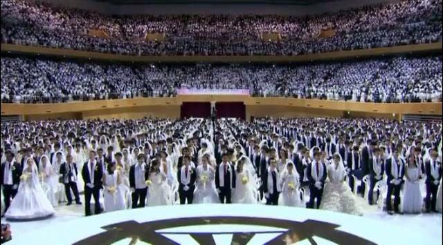 The Moonies mass wedding. Partners were chosen by Rev. Moon